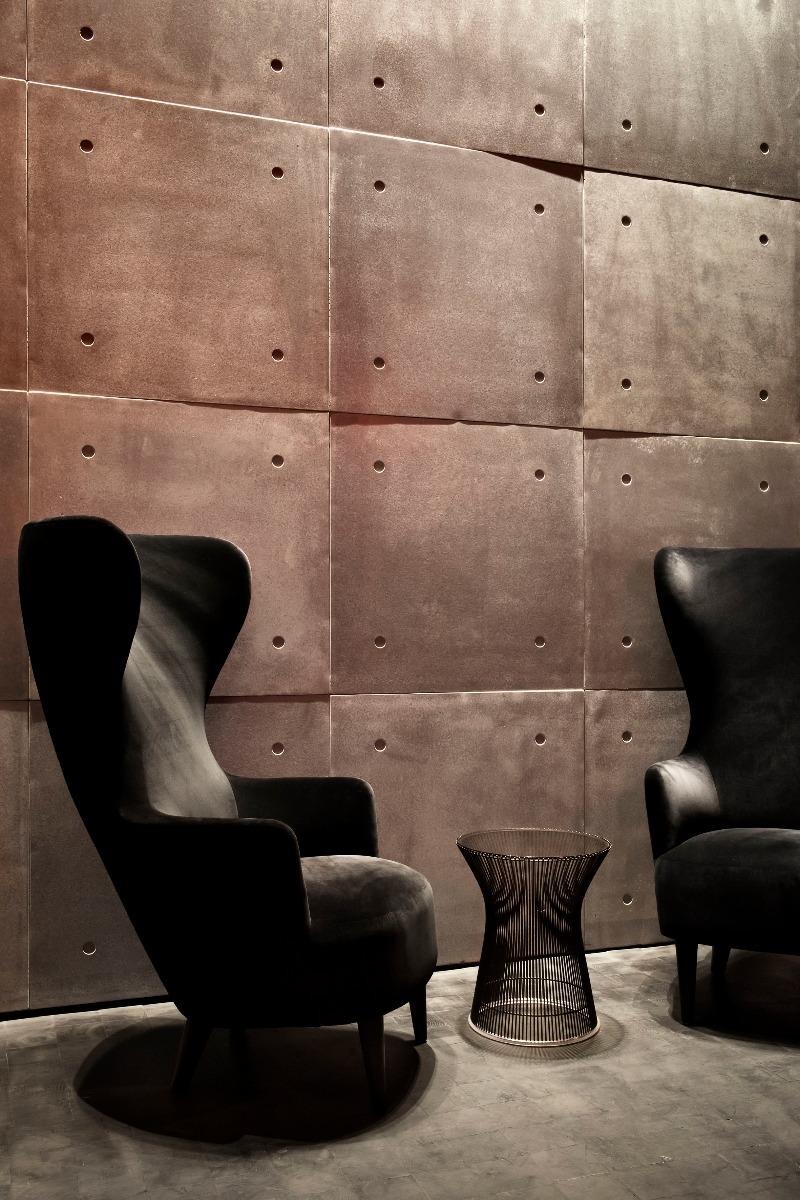 Tom Dixon Himitsu Bar in Atlanta featuring a black velvet Wingback Chair.