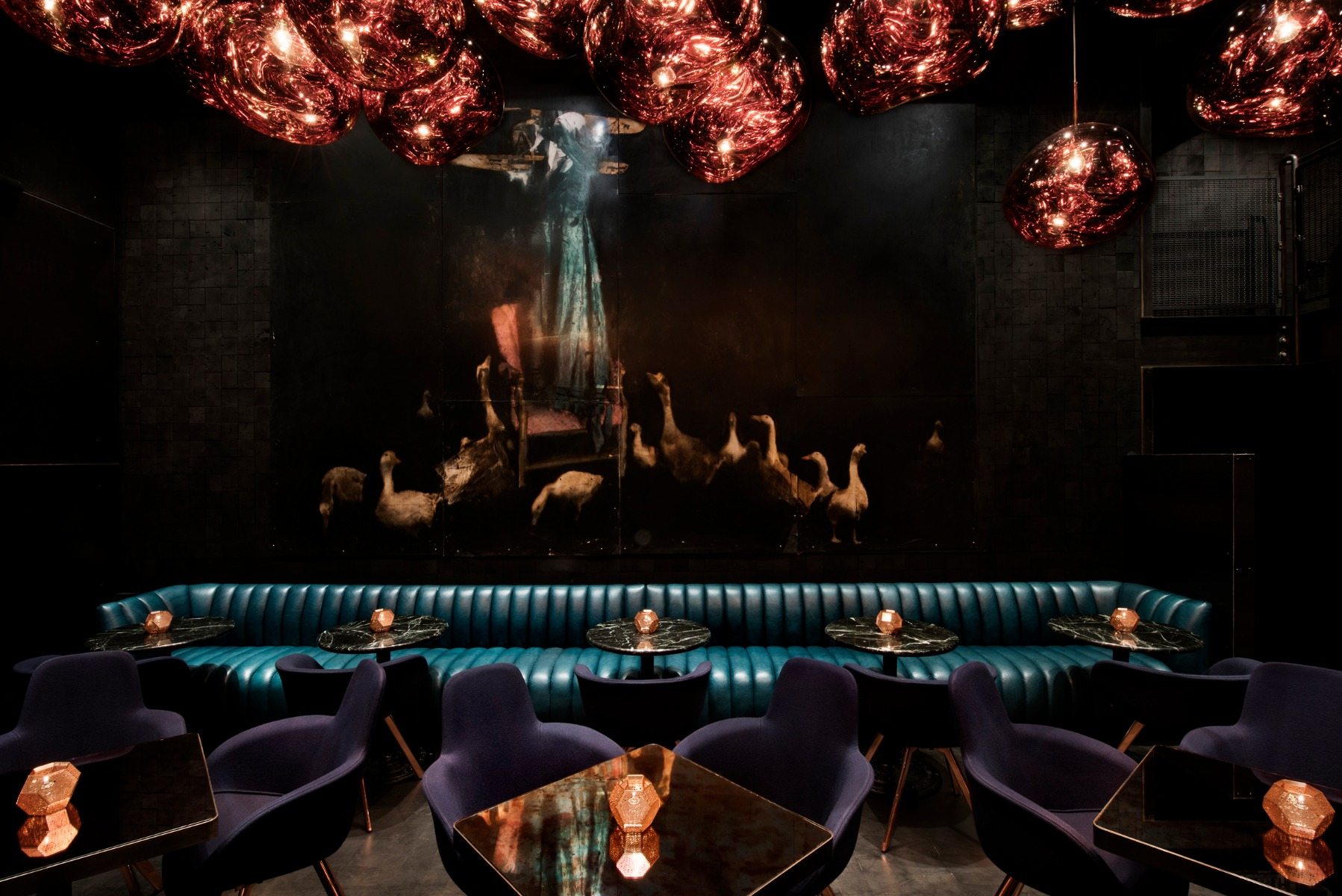 Tom Dixon Himitsu Bar in Atlanta featuring copper Melt pendants, Scoop High Back chairs and copper Etch tea light holders.