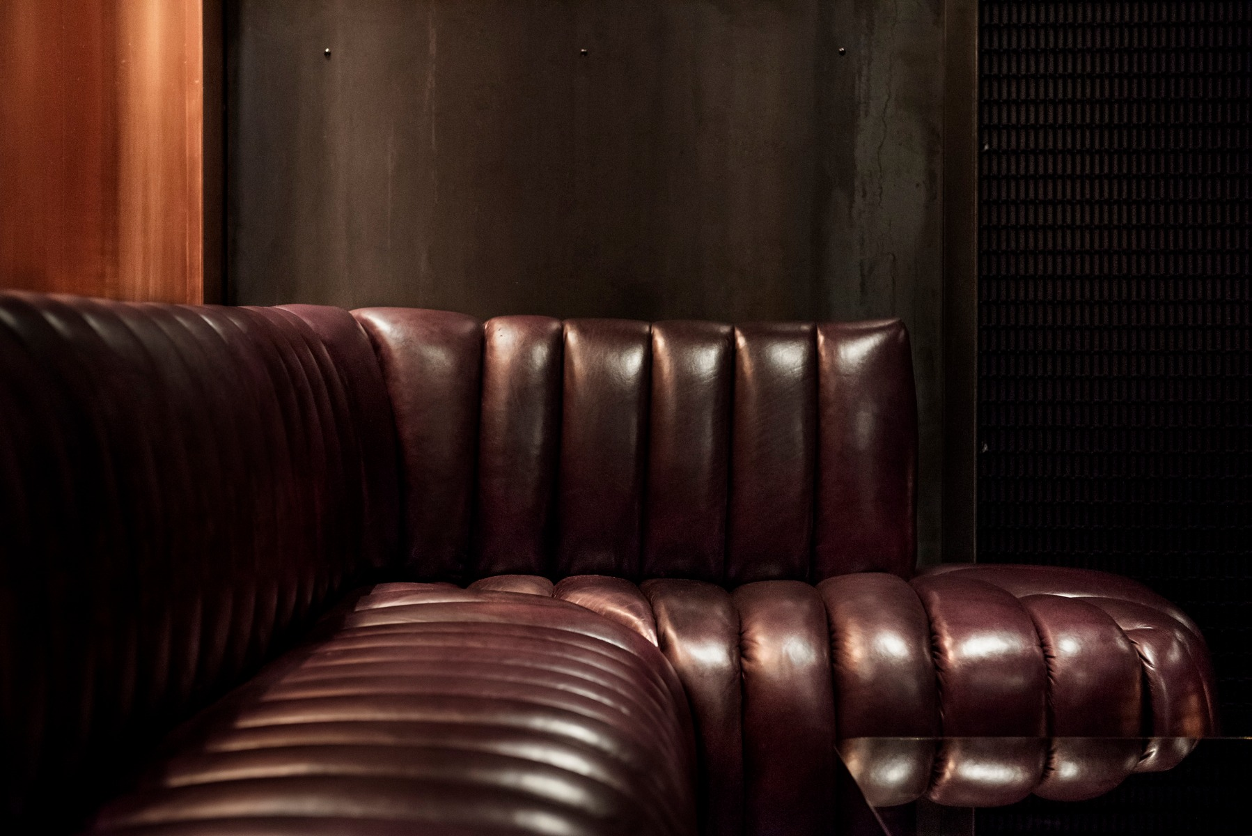 Detail of the custom leather banquette at Himitsu in Atlanta, designed by Tom Dixon Studio.